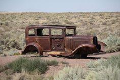 Route 66 - Abandoned car in Arizona desert.