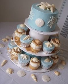 Beach-themed cake and cupcakes