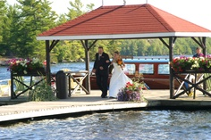 Romantic Weddings - The Bride Arrives in 1922 Vintage Mahogany Motor Launch