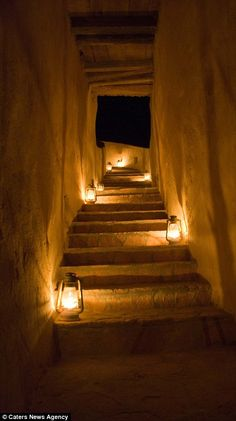 Eco Hotel in Egypt :Romantic lighting: Lanterns illuminate the stairways to the rooms and candles brighten the indoor dining area (left). Guests can also opt to have dinner outdoors