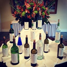 Instead of escort cards, bride Sarah used wine bottles as her seating chart!