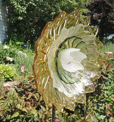 Love this upcycling of old glass for the garden.