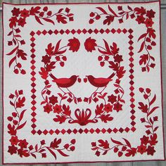 Beautiful red and white quilt.