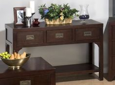Jofran 562-4 Garnett Cherry Sofa Table by Jofran. $282.00. Antique Brass Campaign Hardware. (3) Drawers And Shelf. Width 18. Solid Asian Hardwood And Birch Veneer. Length 48. Garnett Cherry Finished Sofa Table Style TransitionalHeight 29Color BrownFinished Dark Wood