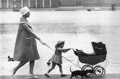 Mother, daughter and dachshund, London, 1959.