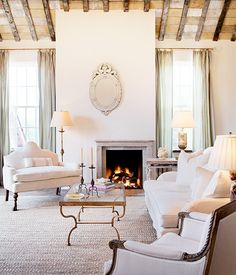 fireplace, Venetian mirror, neutral living room, gilded coffee table, exposed beams