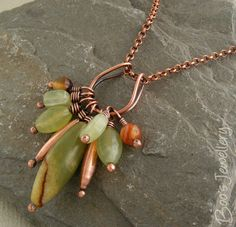 .drop necklace with green and orange