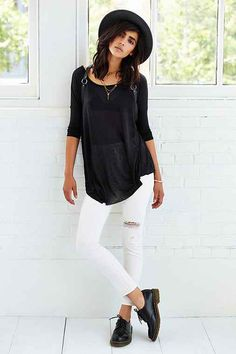 black drape tee and white distressed jeans