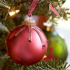 Easy enough for a child to make, this sophisticated, jeweled ornament will add sparkle to the Christmas tree: http://www.bhg.com/christmas/ornaments/easy-ornaments-kids-can-make/?socsrc=bhgpin101714pinkchristmasornament&page=8