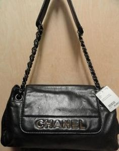 """Chanel Black Lambskin Designer Handbag with Silver """"CHANEL"""" lettering across flap. Silver chain/leather double straps. RARE! Immaculate condition!    $3,895.00"""