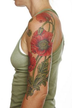Poppy tattoo by Gordon Combs. More on the botanical side than pure art nouveau but has those lovely whiplash curves.