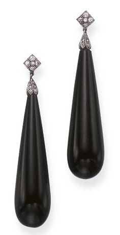 A PAIR OF ART DECO ONYX AND DIAMOND EAR PENDANTS. Each elongated onyx drop, with a rose-cut diamond cap, suspended by a single-cut diamond surmount, mounted in platinum and gold, circa 1920, in a brown leather fitted case.