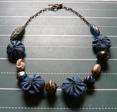 lovely dark and deep necklace - vintage beads and silk yoyos by cookoorikoo