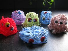 yarn monsters - Cover 3D shape (they used yogurt pots) with cling wrap. Cover with glue and add yarn strips and wiggle eyes. Let dry and remove from forms and cling wrap.