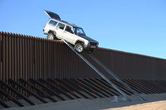 Jeep Cherokee left teetering on border fence after failed crossing attempt [w/video]