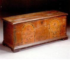 A Chippendale Paint Decorated Pine Blanket Chest, Probably Lancaster County, Pennsylvania, Circa 1800 - Appears to retain its original lock. Height 20 1/2in. by width 50 1/2in. by depth 20in.