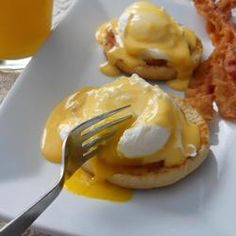 Eggs Benedict from Allrecipes.com.  A brunch favorite made from scratch.  I love when the yellow buttery egg yolks drizzle down over the English muffin....yum!
