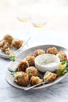 Crab Cake Poppers are served with a spicy aioli dipping sauce. They're a total game day fave. #recipe