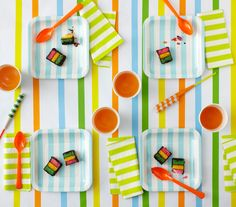 Thrill the birthday boy or girl with a colorful party theme. These decorating and entertaining ideas rely on bright hues and stripes.