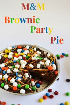 M&M Brownie Party Pie perfect for any occasion and easy to customize for the holidays by changing up the colors of M&M's used. #shop #BakingIdeas #cbias