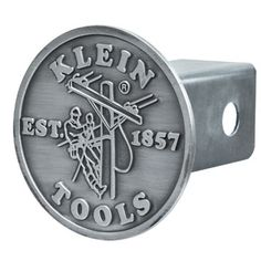 "Trailer Hitch Cover (96767) – New!  A great new way for the ultimate Klein Tools fan to show off their pride!  This pewter-alloy Trailer Hitch Cover features the classic Klein Tools Lineman Logo design. Fits standard 2"" hitch receivers."