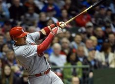 Allen Craig hits a double to drive in a run in the third inning during a game against the Brewers. Cards won 6-1.  4-15-14