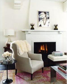 Cozy living room. Sheepskin. Elizabeth Peyton. Saarinen table.