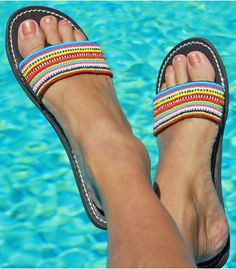 This fun beaded leather sandal has bright rows of stripes across a thick leather strap, with a hidden toe post for extra comfort.