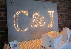 Lighted sign perfect for check in table at wedding