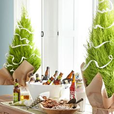 Christmas Buffet Table Trees ~~ Buy real trees at the garden center, use on buffet and the plant outside in early spring.
