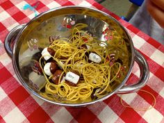 KFUNdamentals:  Spaghetti and Sight Word Meatballs!  Use ModPodge to put sight words on some large beads, and put them in a colander with some rubber band spaghetti.  The children have to use tongs to pull out two sight words that match.