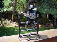 Horseshoe art cowboy with guitar., $65