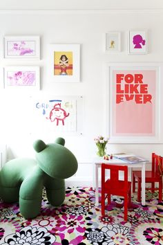 Tour a Cheerful and Elegant Family Home in NYC // floral rug, red play chairs, playful wall art