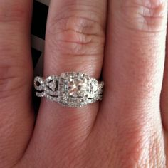 Beautiful rings. Round center-stone, love the bands.