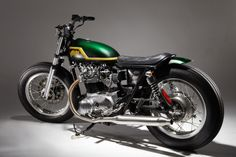 Yamaha xs650 lowered swingarm custom with emerald green tank and yellow stripe by Mark Huang