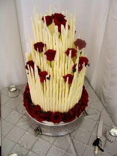 3-tier Wicked Chocolate wedding cake decorated with white chocolate cigars & fresh red roses by Charly's Bakery, via Flickr