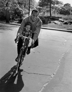Happy Father's Day gentlemen! This is Harry Belafonte taking a ride with his daughter Shari in 1957.
