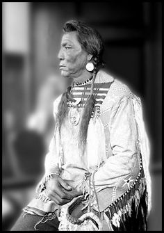 Three-quarter length portrait of White Calf, a Blackfoot Chief, sitting in profile in a room in Chicago, Illinois, wearing Native regalia. Photograph 1925. - Photographs from the Chicago Daily News, 1902-1933.