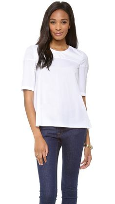 This crisp white blouse from Victoria Beckham is perfect! I would wear this some of my tsavorite pieces from the Fall collection. white blous, swing blous