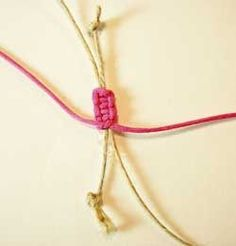 On the underside of your square knot sennit, tie a tight overhand knot.