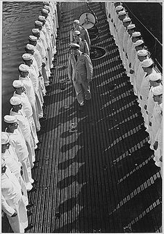 Inspection of personnel aboard a U.S. submarine at New London submarine base, Connecticut, 08/1943, via Flickr.