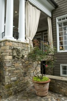 Stone and outdoor curtains