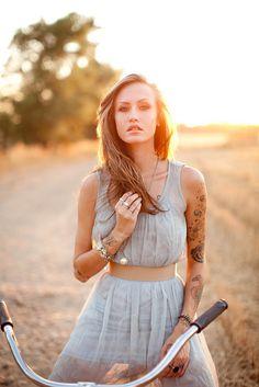 "tattoo. dress. hair. light. I love how she still looks ""girl next door"" and pulls off the sleeve"