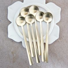 Image of gold coffee spoons