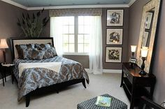 Love the arrangement of this room!!! Also loving the floor-to-ceiling pictures and entry table w/mirror on top!   Chocolate Brown and Blue - Style Estate - decor, wall colors, idea, beds, guest bedrooms, blue, bedroom colors, master bedrooms, guest rooms