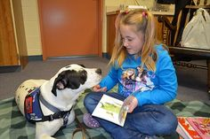 Pearl the Pit Bull - Once abandoned and in need of a leg amputation, this pit bull now helps children learn to read pearl, therapy dogs, leg amput, pit bull