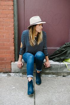 Take your favorite pair of Gap blue jeans from summer to fall. Add a pair of booties and a wool hat for a classic autumn look. Blogger Lou What Wear shows how to pull it all together.