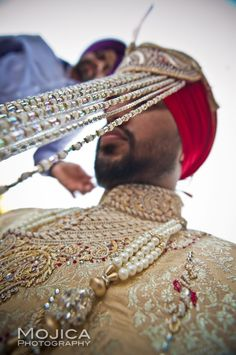Sikh Indian groom sehra red turban via IndianWeddingSite.com