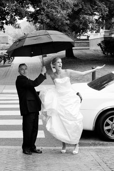 A super cute shot from Leah Valentine Photography. #bride #groom #umbrella #cute #weddingphotography #snapknot