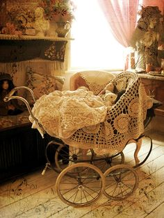 Antique baby buggy with crochet blankets